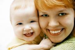 Moeder en baby op wit Stock Foto's