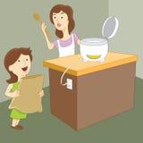 Moeder en Dochter die Rijst maken Stock Foto's