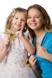Moeder en dochter in feestelijke kleding stock foto's