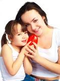 Moeder en dochter met een peper Stock Afbeelding