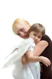Moeder en engelendochter Royalty-vrije Stock Foto's