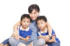 Moeder en tweelingen Stock Foto's