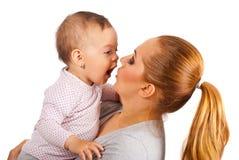 Moeder en verbaasd babymeisje Stock Foto