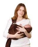 Moeder met baby in een slinger royalty-vrije stock afbeeldingen