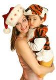 Moeder met baby in kostuums Royalty-vrije Stock Afbeeldingen