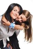 Moeder met dochter die op witte achtergrond wordt geïsoleerdg Stock Foto
