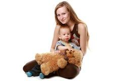 Moeder met geïsoleerdee baby Royalty-vrije Stock Afbeeldingen