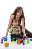 Moeder met geïsoleerdev baby Stock Afbeeldingen