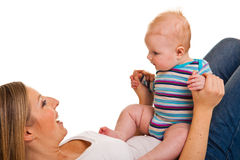 Moeder met gelukkige en leuke zuigeling stock foto's