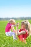 Moeder met haar kind Stock Foto