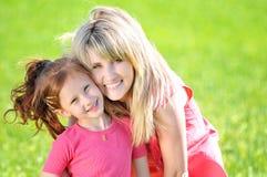 Moeder met haar kind Stock Afbeelding