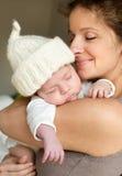 Moeder met haar baby Stock Foto's