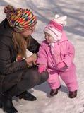Moeder met kind Stock Foto's