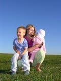 Moeder met kinderen stock afbeelding