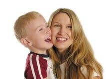 Moeder met kindglimlach Royalty-vrije Stock Afbeeldingen