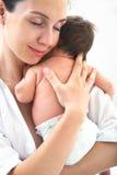 Moeder met weinig baby stock fotografie