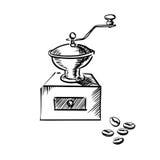 Moedor do moinho de café com feijões de café Imagem de Stock