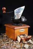 Moedor monetário fotos de stock