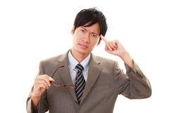 Moeilijk portret van zakenman het kijken stock fotografie