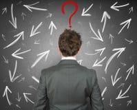 Moeilijke keuzen van een zakenman stock foto