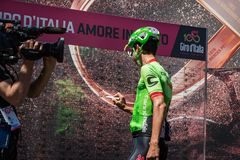 Moena, Italy May 25, 2017: Professional Cyclist Davide Formolo, Cannondale Team, on the Podium signatures. Before departure of hard mountain stage on the Stock Photo
