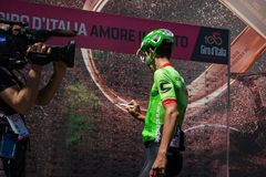 Moena, Italy May 25, 2017: Professional Cyclist Davide Formolo, Cannondale Team, on the Podium signatures. Before departure of hard mountain stage on the Stock Images