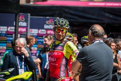 Moena, Italy May 25, 2017: Professional Cyclist Filippo Pozzato during an interview before departure. Of hard mountain stage on the Dolomites of Tour of Italy Royalty Free Stock Photo