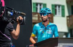Moena, Italy May 25, 2017: Professional Cyclist on the Podium signatures before departure. For a hard mountain stage on the Dolomites in the edition number 100 Stock Image