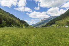 Moena, Trentino Alto Adige, Dolomites, Alps, Italy - June 19, 2018: Beautiful view of the town of Moena in the Dolomite mountains,. Italy. Old town in the royalty free stock photography