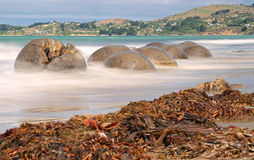 Moeraki Boulders near Hampden, New Zealand. Long time exposure stock images
