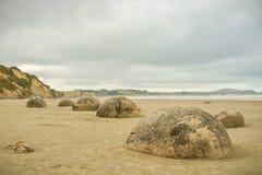 Moeraki Boulders, popular tourist attraction on Koekohe beach near Moearki in New Zealand. Moeraki Boulders, popular tourist attraction on Koekohe beach near stock photography