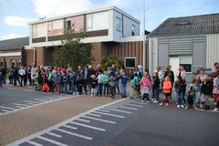 Moerkapelle , The Netherlands - October 3rd 2018 - Queen Maxima of the Netherlands is visiting a company in Moerkapelle, The Neth. Children waiting for the queen stock images