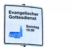 Moers , Germany - February 09 2018 : German sign Translation: Evangelical church service 10 o`clock. In the morning Royalty Free Stock Image