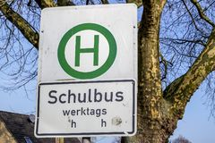 Moers , Germany - February 09 2018 : German sign Translation: school bus working days. MOERS , GERMANY - FEBRUARY 09 2018 : Sign in German Translation: school Stock Photos
