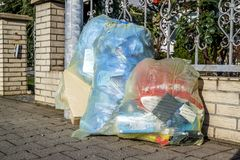 Moers , Germany - February 09 2018 : Typical german waste bags waiting in the street. To be picked up for recycling royalty free stock image