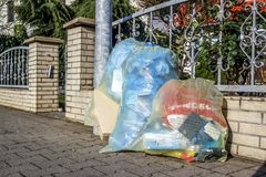 Moers , Germany - February 09 2018 : Typical german waste bags waiting in the street. To be picked up for recycling stock photos