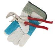 Moersleutel en beschermende handschoen Stock Afbeeldingen