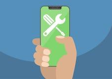 Moersleutel en schroevedraaierpictogram op moderne vatting-vrije/frameless smartphonetouchscreen Overhandig holdingssmartphone Stock Afbeelding