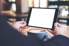 Mofa encima de la imagen de la tableta Imágenes de archivo libres de regalías