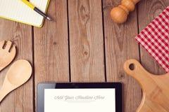 Mofa encima de la plantilla para cocinar el app, exhibición de la receta o del menú Imagen de archivo libre de regalías