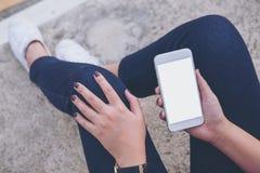 Mofa encima del teléfono elegante Imagenes de archivo