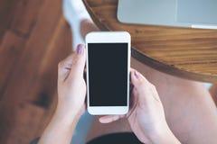 Mofa encima del teléfono elegante Imagen de archivo
