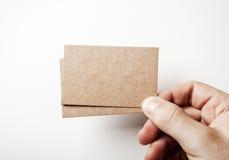Mofa para arriba de dos tarjetas de visita Fotografía de archivo