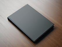 Mofa para arriba del pequeño libro negro en blanco representación 3d Imagen de archivo