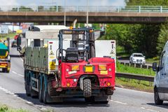 Moffet lorry truck with forklift on uk motorway in fast motion.  stock images