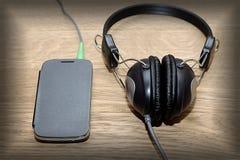 Hełmofony i telefonu rocznika fotografie Obraz Royalty Free
