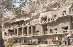 Mogao Caves in Dunhuang, China. This photo is taken in Dunhuang, China, The Mogao Caves also known as the Thousand Buddha Grottoes form a system of 492 temples stock photo