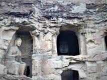 Mogao grottor, skulpturer, konst och religion royaltyfria foton