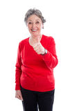 Mogen äldre kvinna för kvinnatummar som upp - isoleras på vit backgroun Arkivfoton