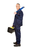 Mogen arbetare med den hjälpmedelpåsen och skiftnyckeln Royaltyfria Foton